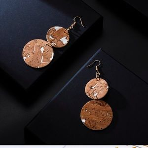 Brand new!!!!  Cork/faux leather circle earring
